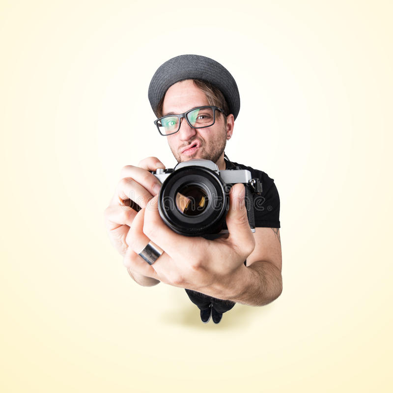 Funny man with a funny surprise expression shooting with his vintage reflex photo camera royalty free stock images