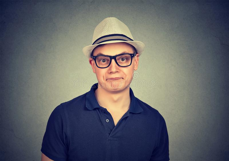 Funny man in glasses making grimace royalty free stock photo