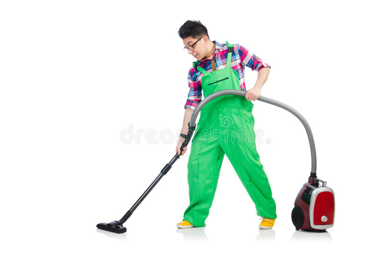 Funny man in green coveralls. Vacuum cleaning stock photography