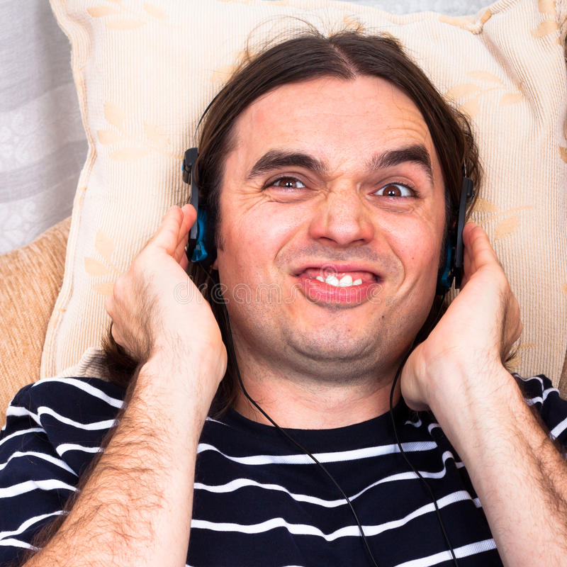 Download Funny Man With Headphones Listening Music Stock Image - Image: 24732475