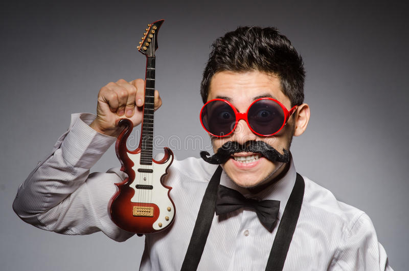 Funny man. With mini guitar royalty free stock images
