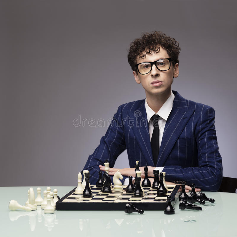 Funny man playing chess royalty free stock photos
