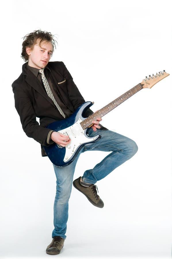 Funny man playing electro guitar royalty free stock photo