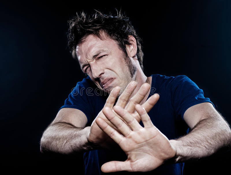 Funny Man Portrait pucker stop. Studio portrait on black background of a funny expressive caucasian man pucker stop rejection stock images