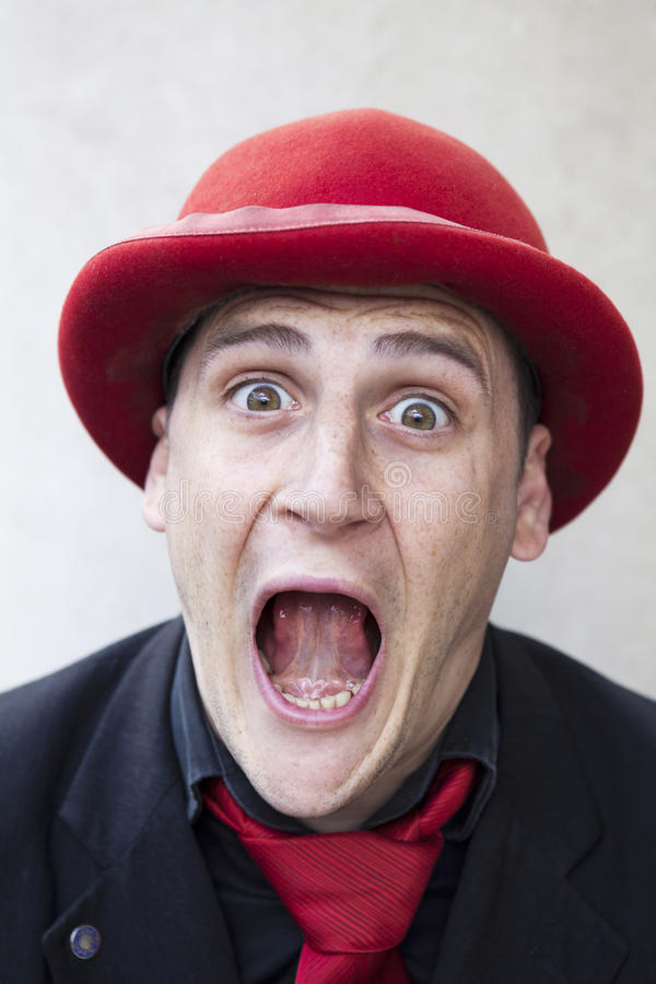 Funny man in red hat. Shouting royalty free stock photography