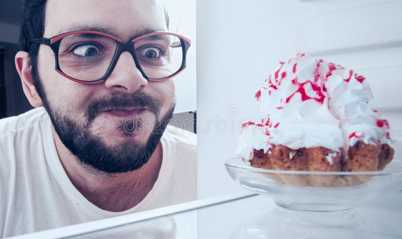 Funny man sees the sweet cake royalty free stock photos