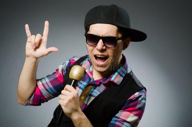 Funny man singing in karaoke stock photo