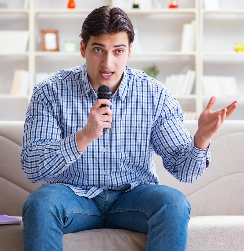 The funny man singing songs in karaoke at home royalty free stock photos