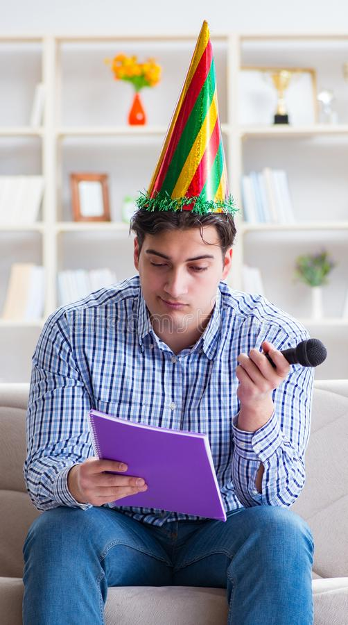 Funny man singing songs in karaoke at home. The funny man singing songs in karaoke at home royalty free stock images