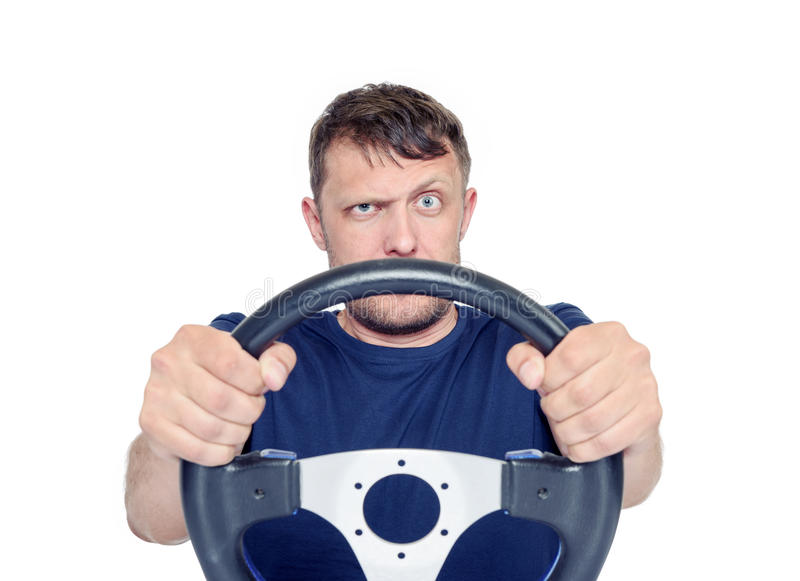 Funny man with a steering wheel isolated on white background, car drive concept.  royalty free stock photography