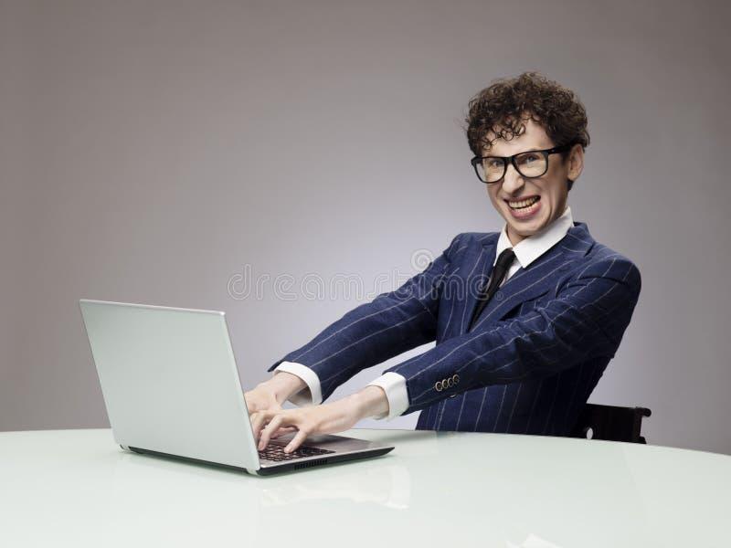 Funny man using laptop stock photos
