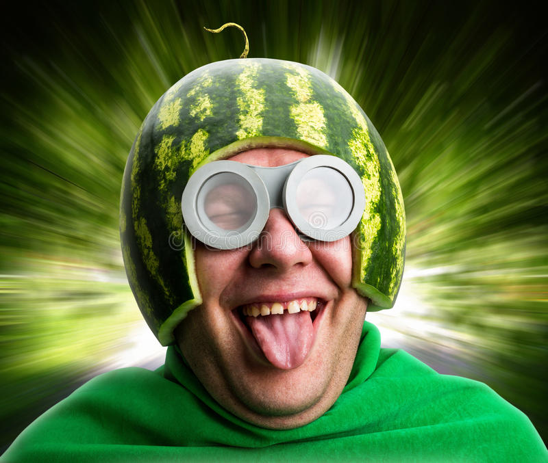 Funny man with watermelon helmet and googles royalty free stock photography