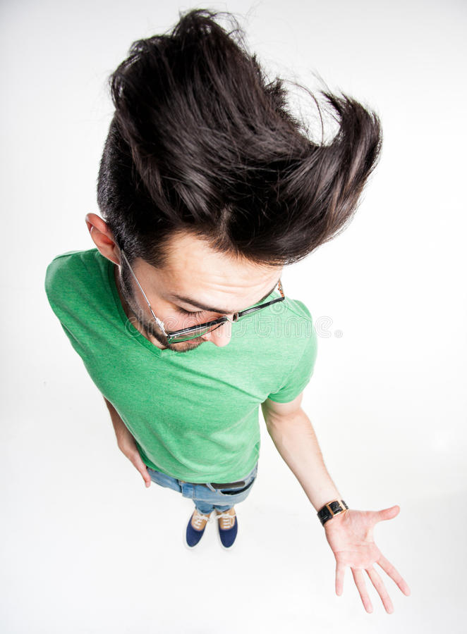 Download Funny Man With Wierd Hairstyle Showing His Palm - Wide Angle Royalty Free Stock Photography - Image: 30678307