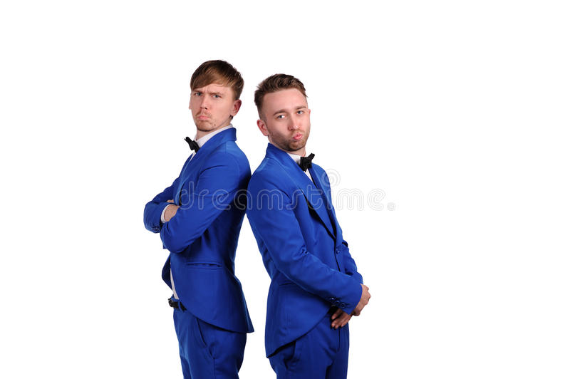 Funny men dressed in blue suite with different emotions. On white background royalty free stock image