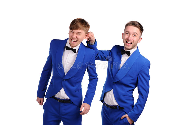 Funny men dressed in blue suite with different emotions. On white background royalty free stock photography