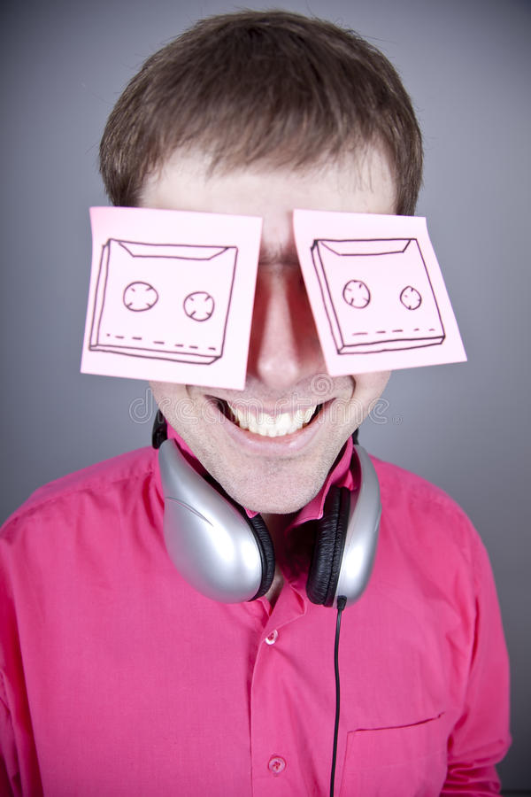 Funny men with notes and headphone.