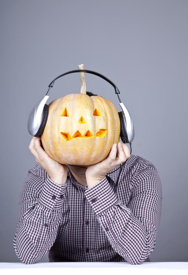 Download Funny Men With Pumpkin And Headphone. Stock Photo - Image of hair, emotion: 16752948