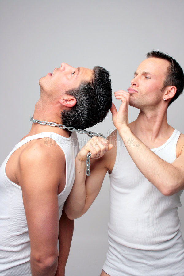 Funny Men with steel chain in underwear. Two guys with steel chain looking hairs stock photo