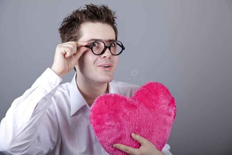 Funny men with toy heart.