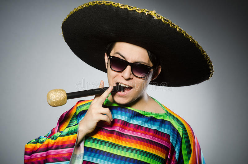 Funny mexican singing in karaoke. The funny mexican singing in karaoke royalty free stock image
