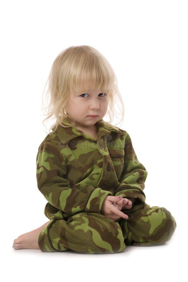Funny military little girl stock photo