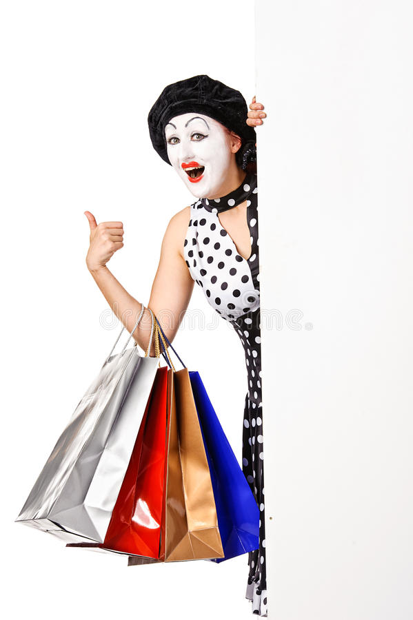 Funny mime woman holding shopping bags. stock images