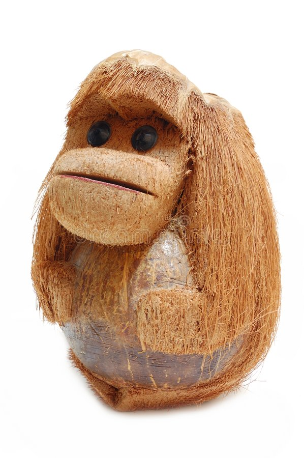 Funny monkey. Carved in coconut isolated over a white background royalty free stock images