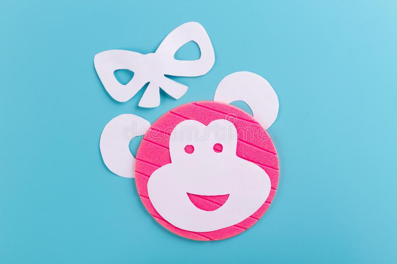 Funny monkey made of paper. Blue background royalty free stock photo