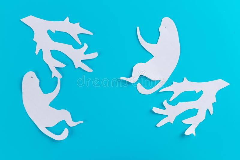 Funny monkey made of paper. Blue background stock image