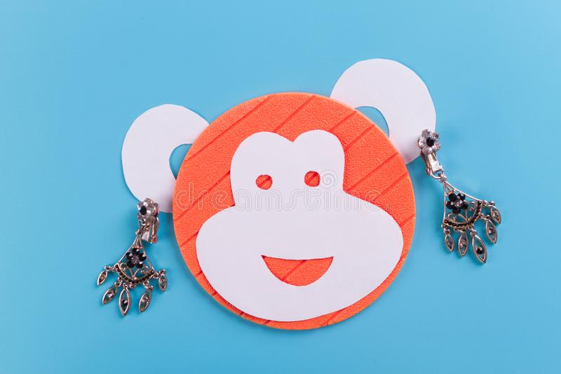 Funny monkey made of paper. Blue background royalty free stock image