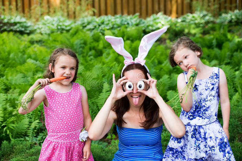 Funny Mother with Children Wearing Bunny Ears and Silly Eyes stock images