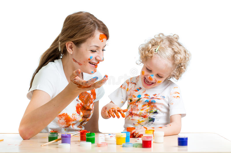 Funny mother and kid girl paint stock image