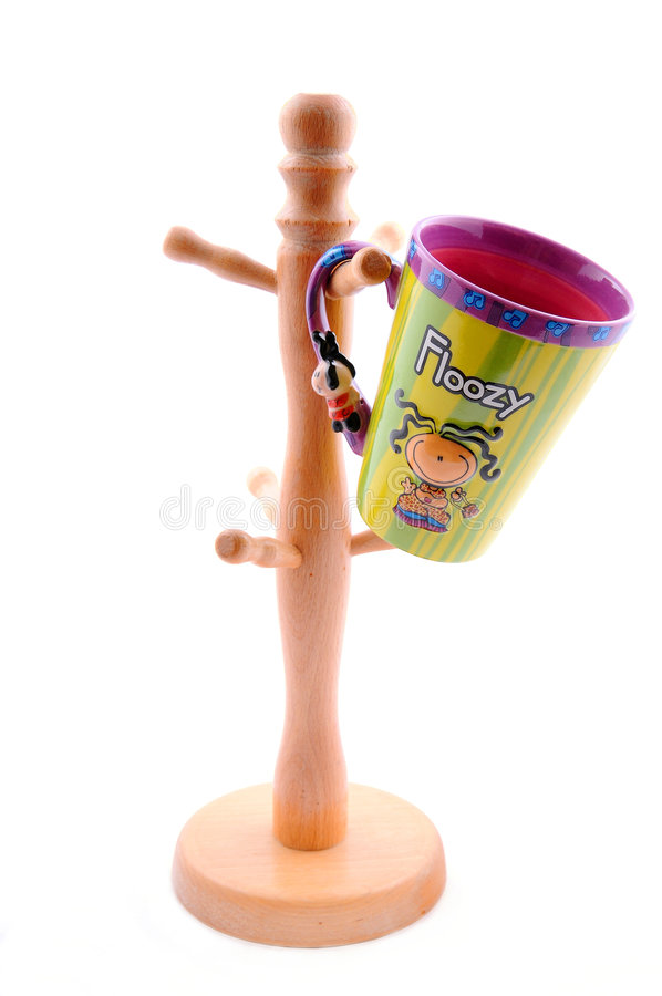 Funny mug with floozy girl hanging on a hanger royalty free stock images