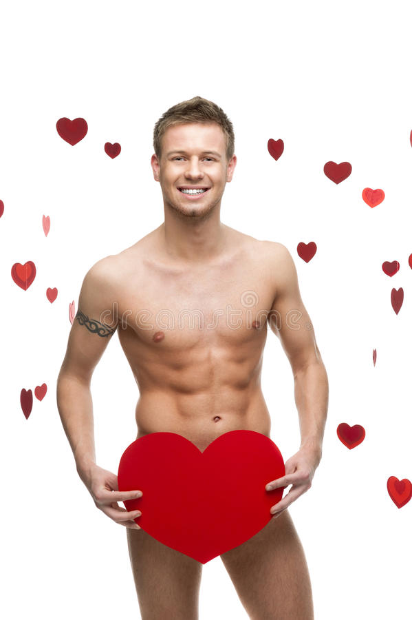 Funny naked man holding big red paper heart stock images