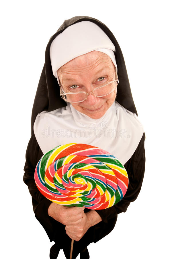 Funny nun with lollipop stock images
