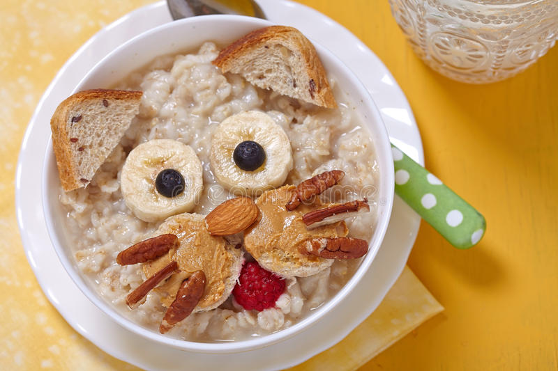 Funny oatmeal with cat face decoration royalty free stock images