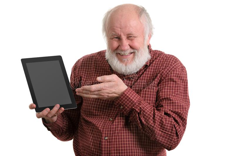 Funny old man using tablet computer isolated on white royalty free stock photos
