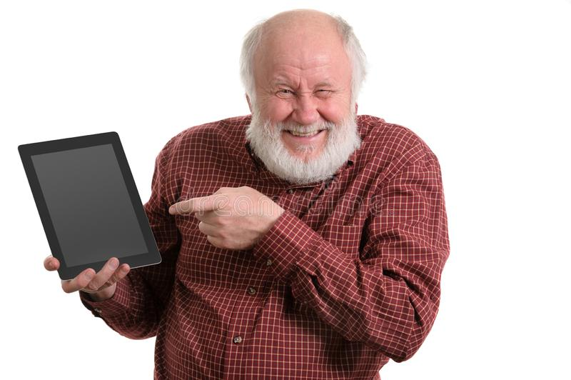 Funny old man using tablet computer isolated on white royalty free stock photo