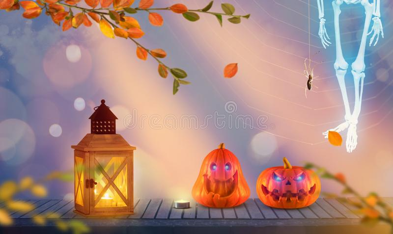 Two funny halloween pumpkins with spooky skeleton ghost over heads on wood with autumn branches and spider web in the background. stock photo
