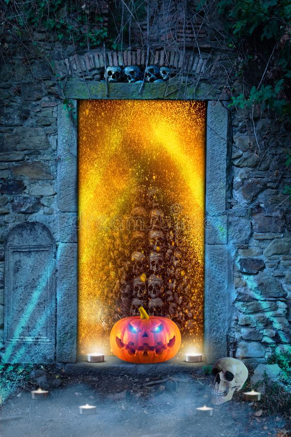 A funny orange pumpkin with glowing eyes in front of hell`s door royalty free stock photography