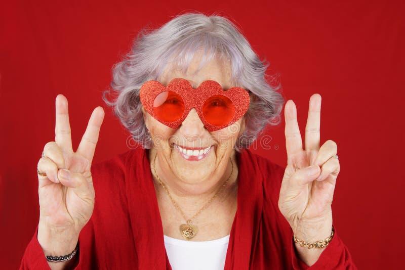 Funny peace and love senior woman stock photos