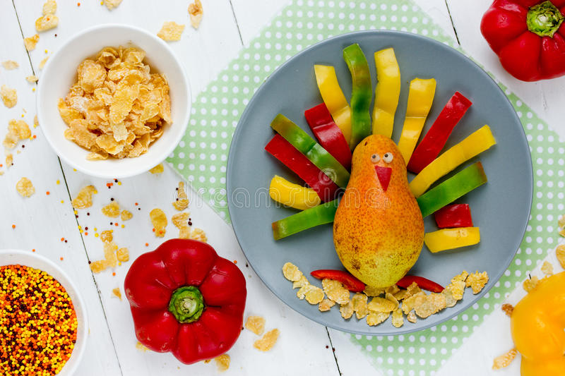 Funny pear colorful pepper Thanksgiving turkey morning breakfast royalty free stock photos