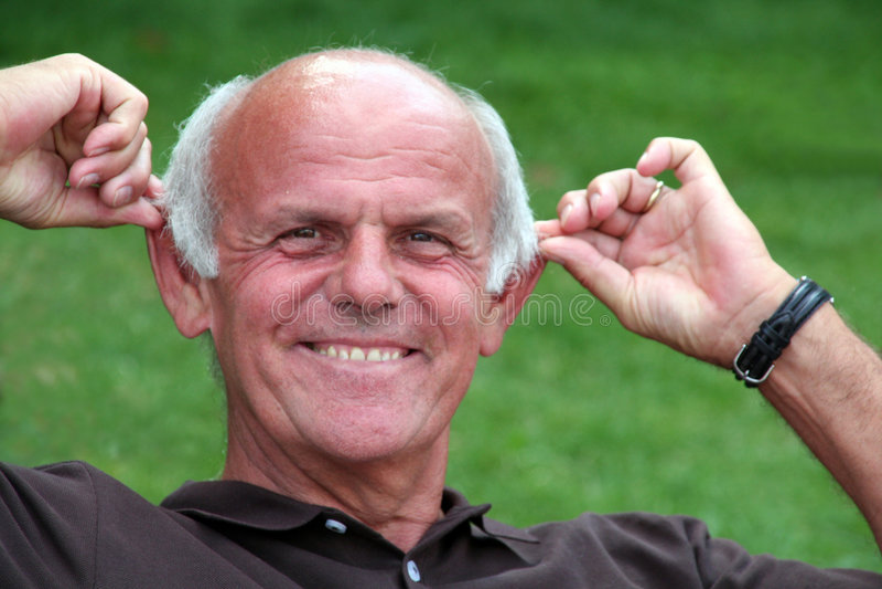 Funny Pensioner. Pensioner enjoying life stock image