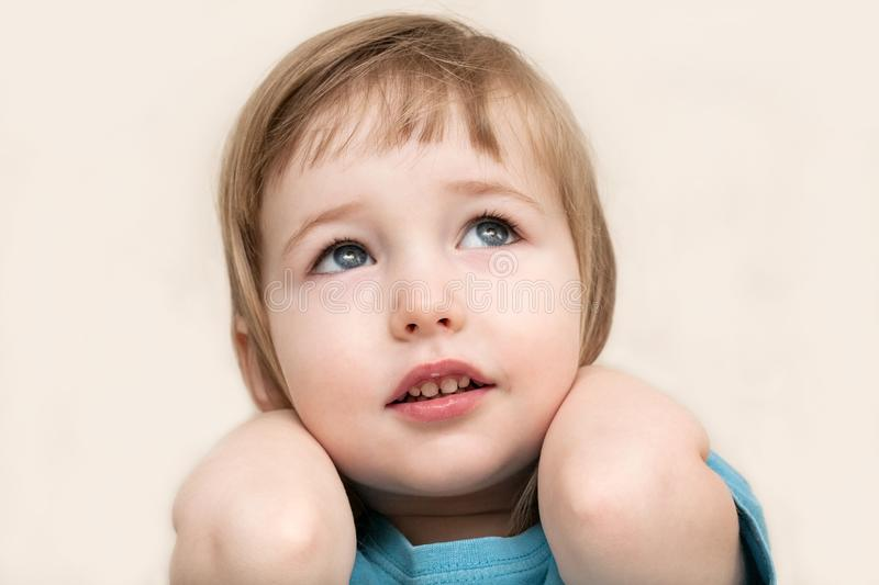 Funny pensive emotional white child girl face closeup royalty free stock photo