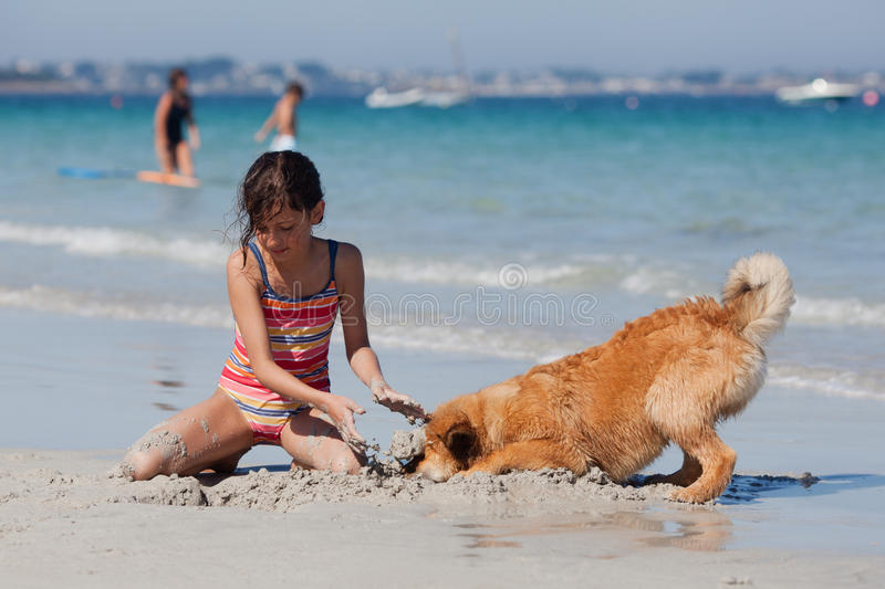 Funny picture of a girl with her dog royalty free stock photo