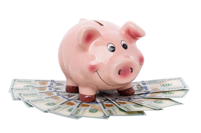 Funny piggy bank standing over heap of money royalty free stock photos