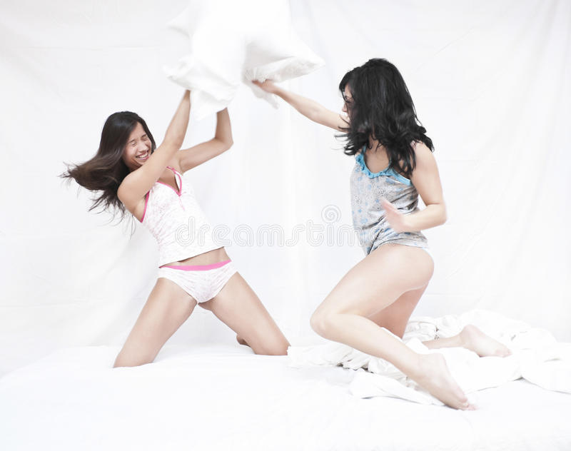 Download Funny pillow fight stock photo. Image of bedroom, pajamas - 23788208
