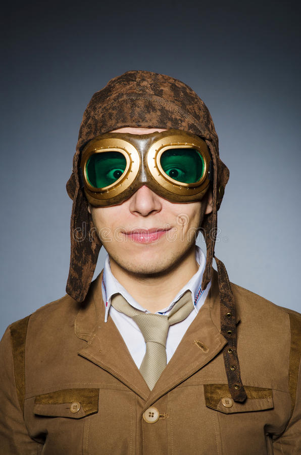 Funny pilot with goggles. And helmet stock image