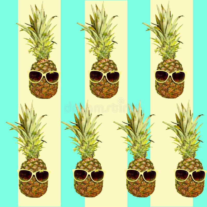 Funny Pineapples fruits in sunglasses pattern. Summer holidays and party theme background. Funny Pineapples fruits in sunglasses pattern. Summer holidays, party stock photography