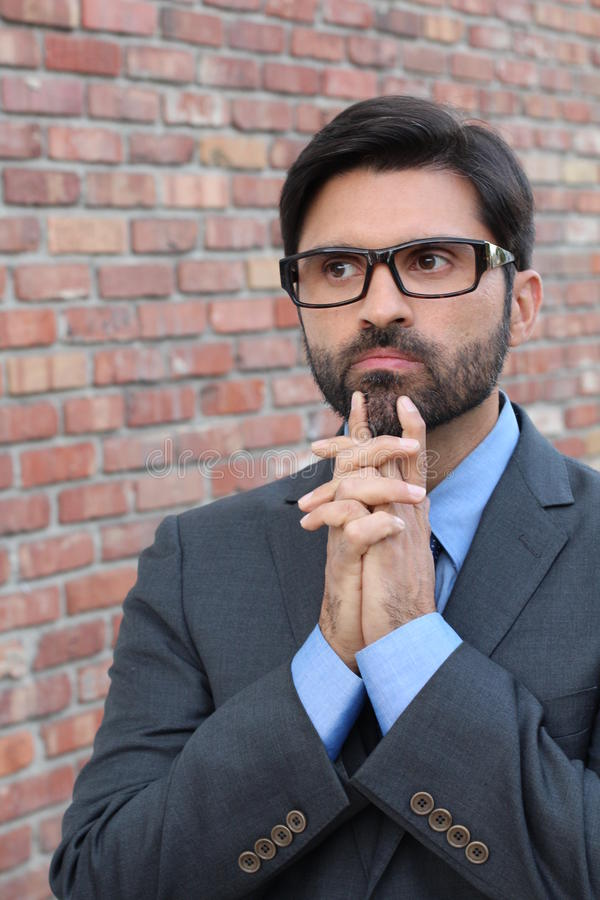 A funny pondering businessman with glasses stock images
